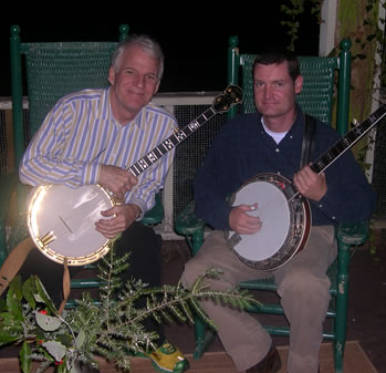 Charles Wood (right) playing dueling banjos with comedian Steve Martin.